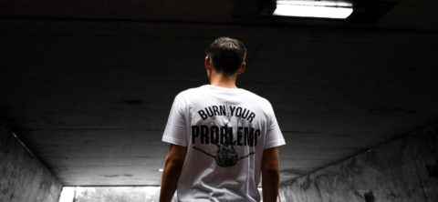 Man with back to viewer wearing a T-shirt with